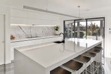 White minimalist galley kitchen