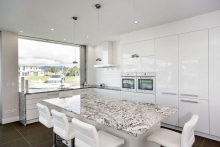 White gloss kitchen with granite benchtops