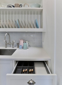 White scullery behind main kitchen