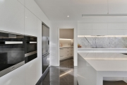 Scullery in white minimalist kitchen