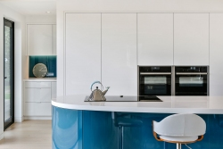 White and teal blue kitchen