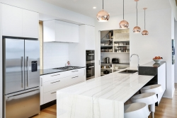 Scullery at end of white kitchen