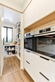 Walk-in pantry in scandi style kitchen