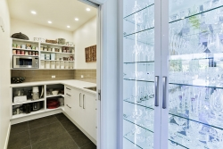 Glass display cabinets outside scullery