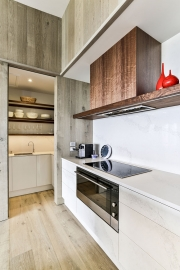 Timber veneer kitchen with scullery