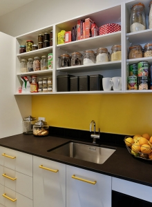 Stylish scullery in white, yellow and black
