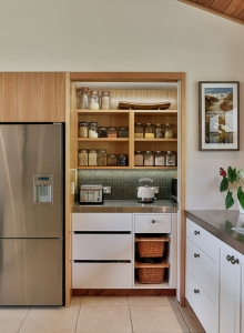 Warm and inviting hidden pantry