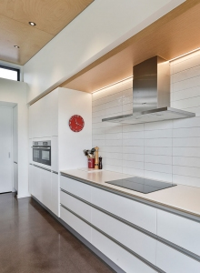 White tiled splashback and profile handles