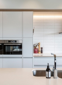 Flush panel cabinetry gives a smooth, uncomplicated look