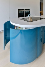Lacquered, curved kitchen cabinetry