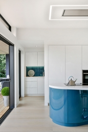 White minimalist kitchen and scullery with blue tones