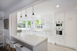 Clean white country kitchen