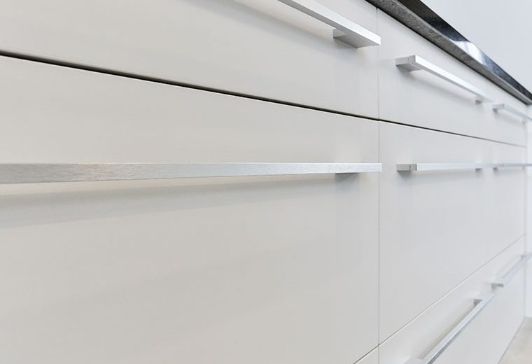 sleek white kitchen cupboards silver handles