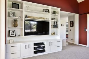 custom made shelving in living room lounge entertainment unit