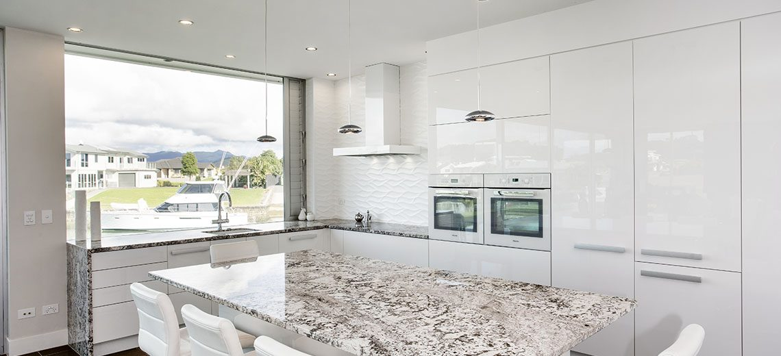 sleek white minimalist kitchen granite benchtop