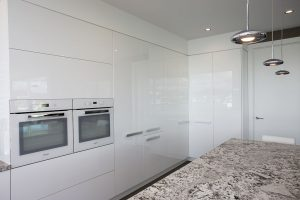 sleek white minimalist kitchen