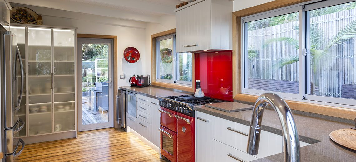 kitchen red oven timber floors
