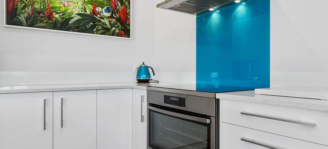 white kitchen blue kitchen splashback