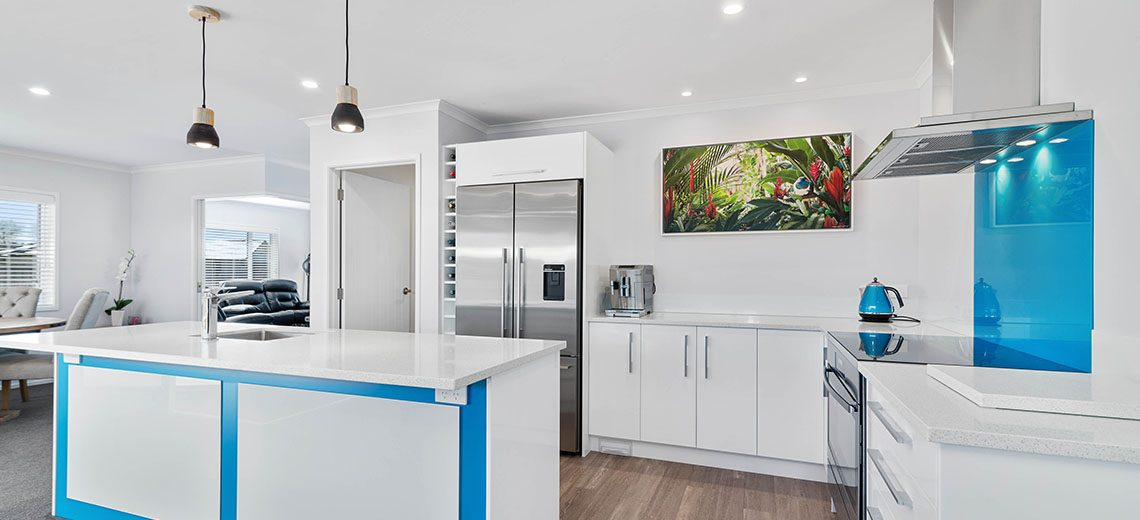 white modern kitchen with blue colourful kitchen