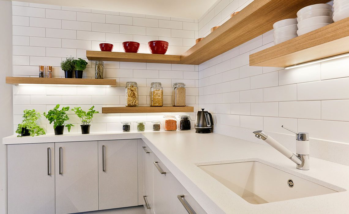 Kitchen with white brick and wooden shelves