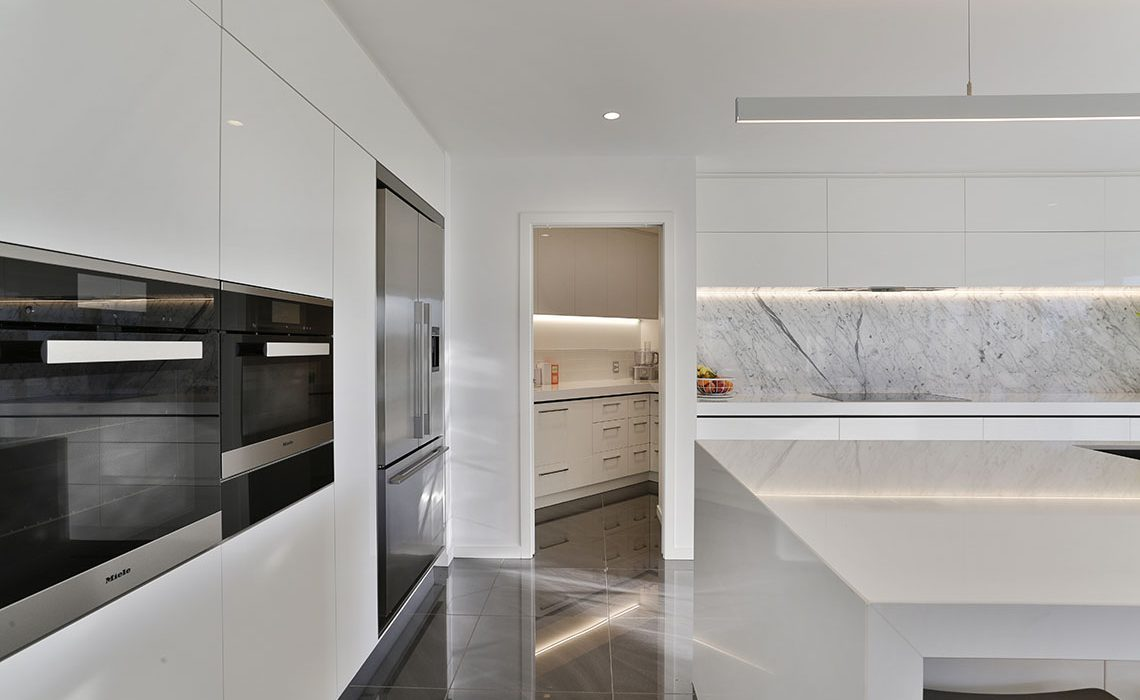 White galley kitchen with butlers pantry