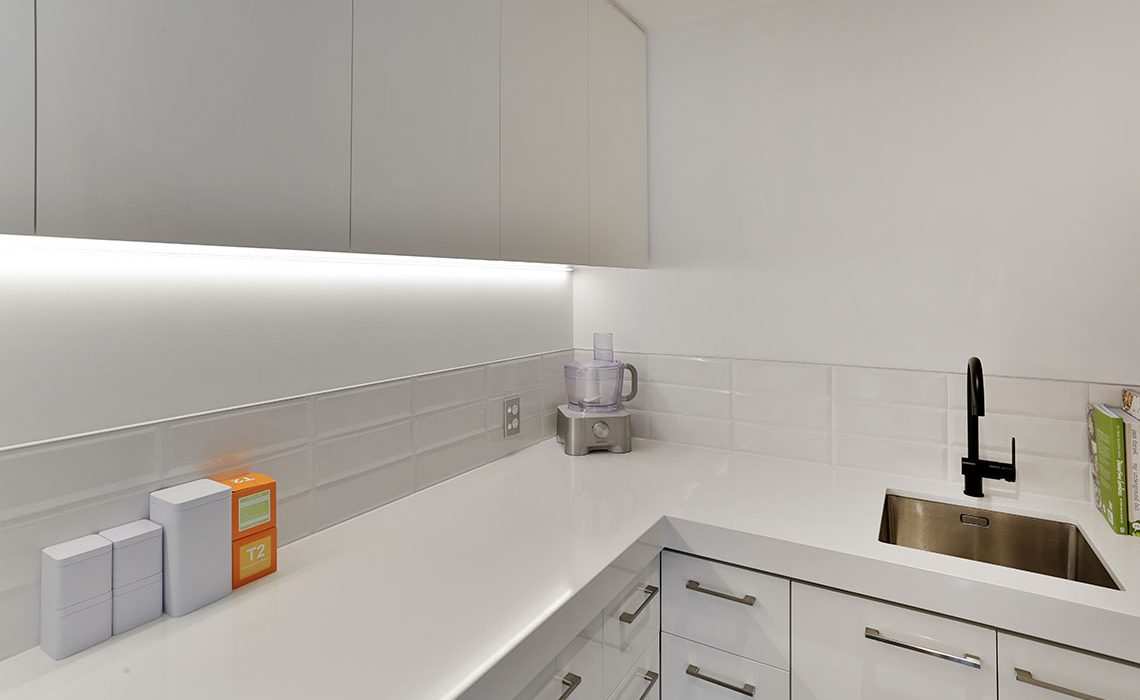 White butlers pantry with task lighting LED strips
