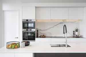 white minimalist kitchen double wall oven