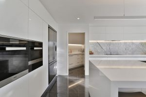 white kitchen look through to scullery