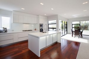 white minimalist kitchen timber flooring
