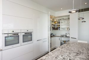 white kitchen pantry doors open