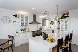 white cape code style kitchen