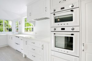 white country kitchen while wall oven smeg