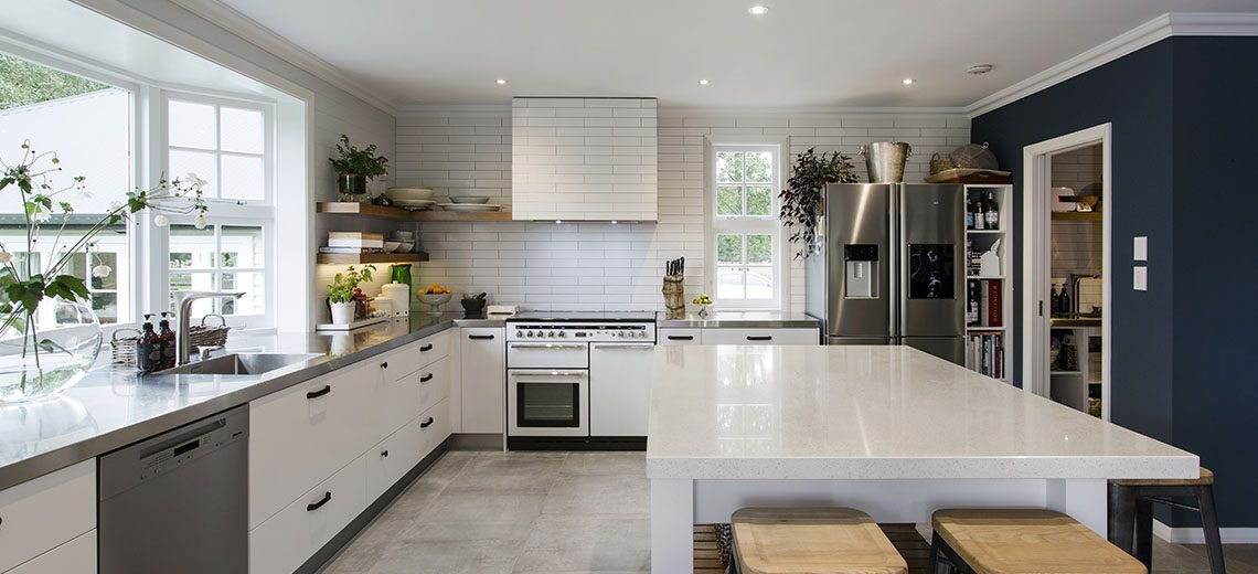white country kitchen with stainless steel