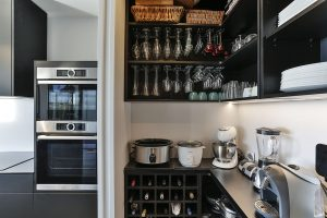 walk in pantry scullery black shelves wine glass racks