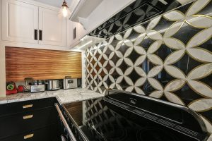 villa kitchen with tiled splashback