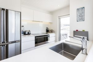 white handleless kitchen stainless steel appliances