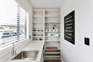open shelves in scullery with window and sink