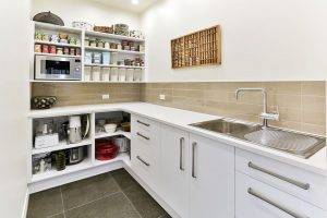 large scullery cupboards open shelving sink