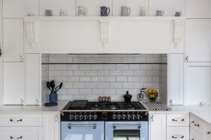white country kitchen white oven range tile splashback