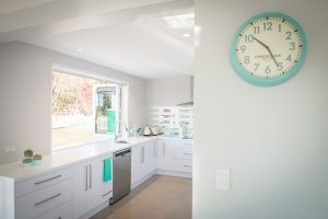 fresh white kitchen aqua accents