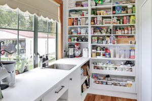 country style scullery floor to ceiling shelves