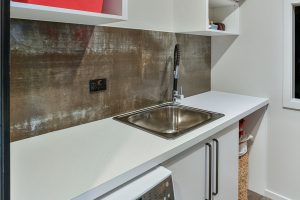 laundry with textured splashback