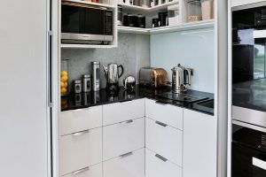 small walk in pantry black benchtop