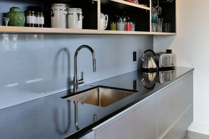 scullery black bench grey cabinets