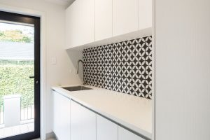 White laundry with patterned splashback