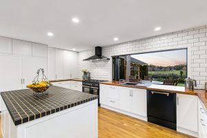 country kitchen timber and white brick splashback